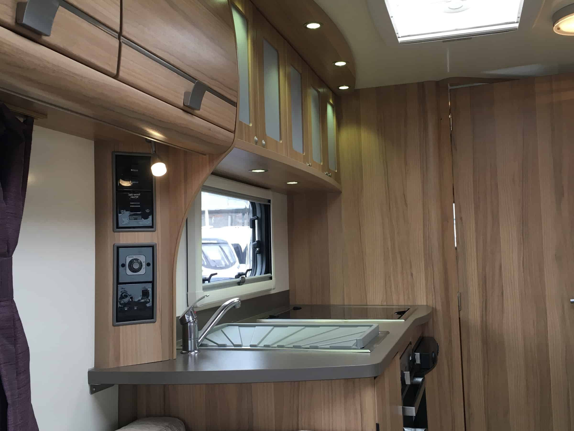 Bailey Pegasus Genoa S2 2013 2 berth caravan stunning rear washroom with lovely lounge and a very ample kitchen .